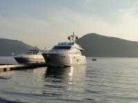 Motor Yachts on Pontoon at Sunset