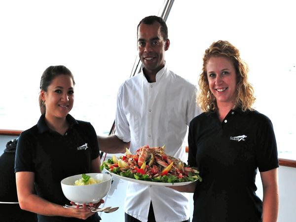 Chef and stewardesses onboard Sealion